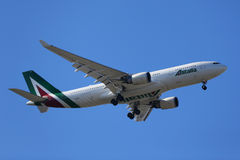 Alitalia Airbus A330 descends for landing at JFK International Airport in New York. NEW YORK - APRIL 18, 2017: Alitalia Airbus A330 descends for landing at JFK Royalty Free Stock Photo