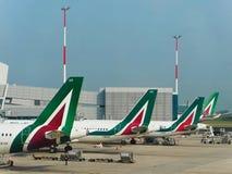 Alitalia Airline Airplanes parked. Fiumicino, Rome - April 2018: Alitalia Airline Airplanes parked at Leonardo da Vinci Airport Stock Photos