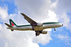 Alitalia airplane landing Royalty Free Stock Photos