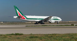 Alitalia Boeing 777 on the runway Royalty Free Stock Photos