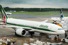 Alitalia Boeing 777 towed at Narita International Airport, Japan. Alitalia is the flag carrier and national airline of Italy Royalty Free Stock Image