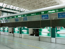 Alitalia check-in desks. At the Fiumicino airport, Rome, Italy. Alitalia is Italy's biggest and the world's 19th airline stock images