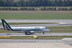Alitalia Embraer erj190 taxiing to gate at Vienna Airport royalty free stock image