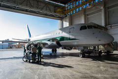 Alitalia Embraer in Hangar Stock Images