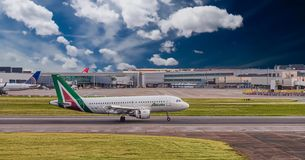 Alitalia at Heathrow. LONDON, UK - October 1, 2016: Heathrow Airport is the second busiest airport in the world by international passenger traffic, as well as stock photography