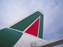 Alitalia, italian airline company. Vertical Rudder of Alitalia Boeing 777 Aircraft. Photo taken at Roma Fiumicino International Airport in March 2012 Royalty Free Stock Photo