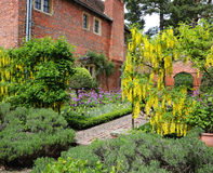 An English walled garden with path and house Stock Photo