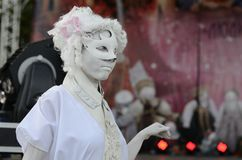 Alive sculpture masquerade style performance. A young woman wearing a mask during her alive sculpture performance Royalty Free Stock Image