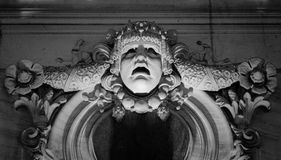 Alivio de Bas de la cara vieja de la piedra de construcción Imágenes de archivo libres de regalías