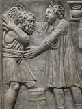 Alivio de bas tallado egipcio de dos hombres Imagen de archivo libre de regalías