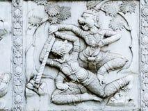 Alivios bajos de la pared del templo de Tailandia, Ayutthaya, tallas de los extranjeros, dioses fotografía de archivo libre de regalías