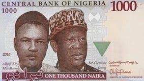 Aliyu MaiBornu和宽容Isong画象在尼日利亚人1000 nair 库存图片