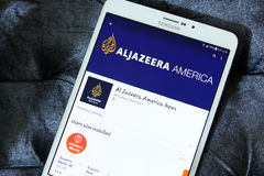 Aljazeera america app logo. Downloading tv channel aljazeera america application from google play store on samsung tab s2 stock image