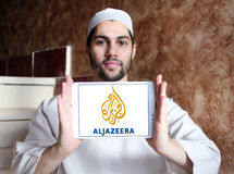 Aljazeera news channel logo. Logo of aljazeera news channel on samsung tablet holded by arab muslim man royalty free stock image