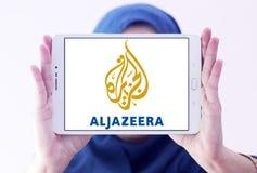 Aljazeera news channel logo. Logo of aljazeera news channel on samsung tablet holded by arab muslim woman stock image