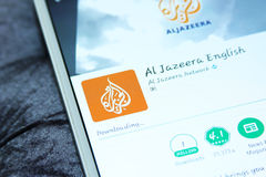 Aljazeera news mobile app. Downloading aljazeera news application from google play store on samsung tab s2 stock photos