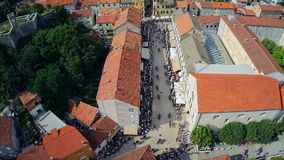 Alka procession in center of town Sinj, aerial. SINJ, CROATIA - August 3, 2014: Copter aerial view of the Alka procession passes through the town. Part of stock footage