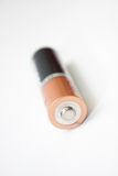 Alkaline battery on a white background Stock Images