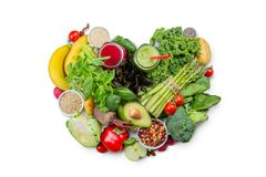 Alkaline diet concept - heart shaped fresh foods on rustic background Stock Photography