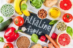 Alkaline diet ingredients. Healthy food background, trendy Alkaline diet products - fruits, vegetables, cereals, nuts. oils, white marble background top view Stock Photography