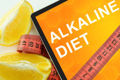 Alkaline diet on tablet. Royalty Free Stock Photos