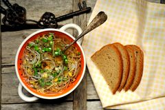 Alkaline, healthy food : soybeans sprout soup and bread royalty free stock photography