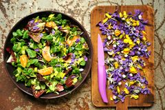 Alkaline, food salad with flowers, fruit and valerian salad Stock Images