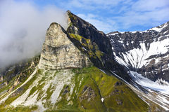 Alkhornet mountain on the northern side of the entrance to the inlet of Isfjorden near the bay of Trygghamna. Alkhornet is a bird cliff at the northern entrance Royalty Free Stock Photography