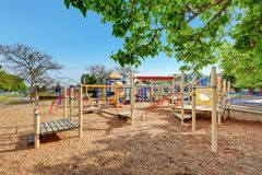 Alki Playground with children run, slides and swings. Stock Image