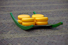 Alkmaar cheese. Stretcher with cheese in the market of city Alkmaar, the Netherlands Stock Photos