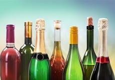 Alkoholów napojów butelki na lekkim tle Obrazy Royalty Free