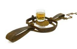 Alkoholisches Getränk ist eine Falle Lizenzfreie Stockfotografie