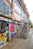 Allée d'échelle d'art de mur de briques de graffiti en Allemagne Images libres de droits