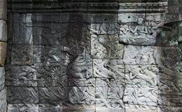 Allégement de Bas dans Bayon, Angkor. Siem Reap. Le Cambodge Photographie stock
