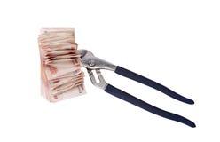 Allégorie de la crise financière globale - le rouble russe dans la poignée de la crise économique Images stock