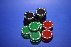 All-in. Poker chips on a blue background stock image
