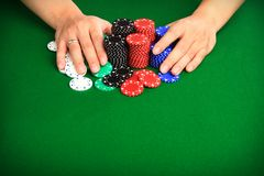 All In. Player pushing chips into the pot going all in. Copy space for your design Royalty Free Stock Photos
