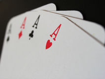 All the Aces. Full set of aces shown in macro close up, focus on Ace of Hearts Royalty Free Stock Photos