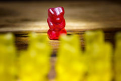 All against one. Gummy bear all against one yellow against red Royalty Free Stock Photo