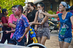 All ages having fun in Songkran, Thailand. Bangkok / Thailand - 15 April 2012: Songkran is a very important Thai tradition. During that time everyone comes out Royalty Free Stock Photo