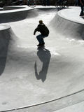 All Alone. Skate boarder traversing the bowl by himself Stock Photo