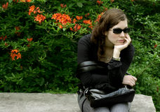 All alone. A pretty woman all alone waiting stock photography