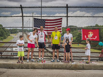All American families on July 4th. Two American families overlooking a highway after running a short marathon. The highway, American flag, Marine flag and Stock Photos