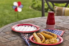 All American hotdogs at a cookout. A holiday cookout and picnic complete with hotdogs and potato chips. One image in a series of patriotically themed images royalty free stock photos