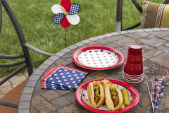 All American hotdogs at a holiday BBQ. A cookout and picnic complete with grilled hotdogs and potato chips. One image in a series of patriotically themed images stock image