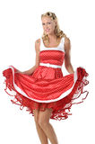 All American Pinup Girl. Pretty blonde pinup model in a red and white polka dot dress and lace parasol royalty free stock photos
