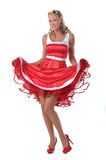 All American Pinup Girl. Pretty blonde pinup model in a red and white polka dot dress jitterbugging Royalty Free Stock Photos