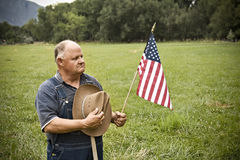 All-American Senior Man. An old male farmer shows his national pride while working in his fields in the heartland of America Royalty Free Stock Photo