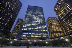 All around. Inner city office complex by early night Stock Images