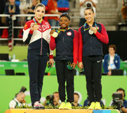 All-around gymnastics medalists at Rio 2016 Olympics Aliya Mustafina of Russia (L),Simone Biles and Aly Raisman of USA Royalty Free Stock Image